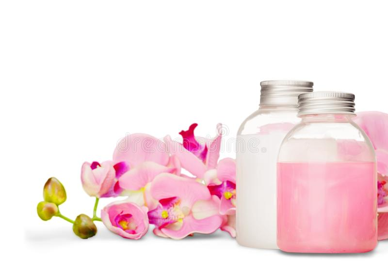 Cosmetics. Shampoo spa treatment orchid flower bottle aromatherapy oil stock image