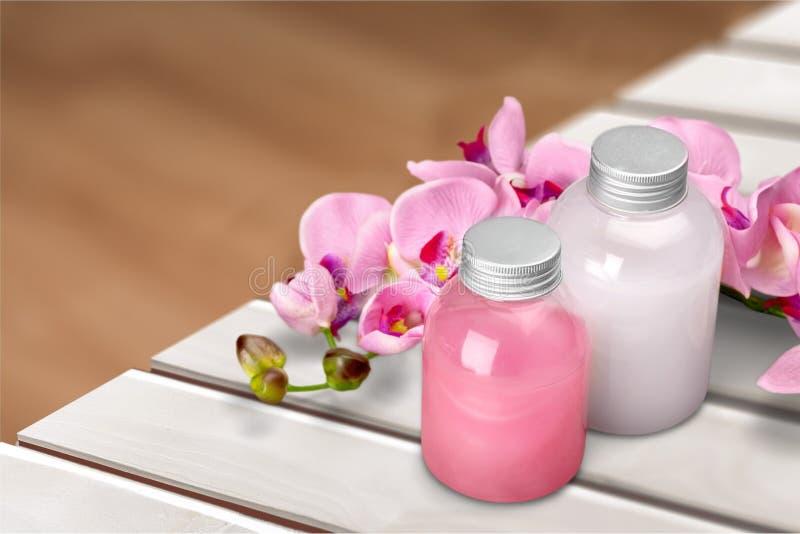 Cosmetics. Shampoo spa treatment orchid flower bottle aromatherapy oil stock photo
