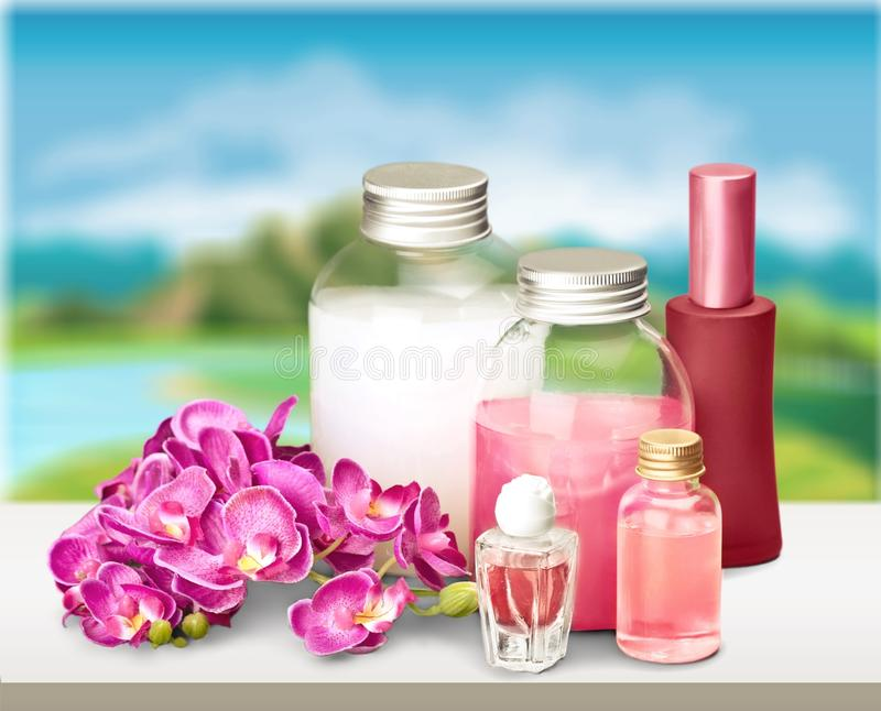 Cosmetics. Shampoo spa treatment orchid flower bottle aromatherapy oil royalty free stock photo