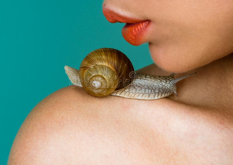 Cosmetics and snail mucus. Cosmetology beauty procedure. Girl and cute snail. Skin care. Massage with snail. Skincare. Repairing. Healing mucus. Having fun with royalty free stock images
