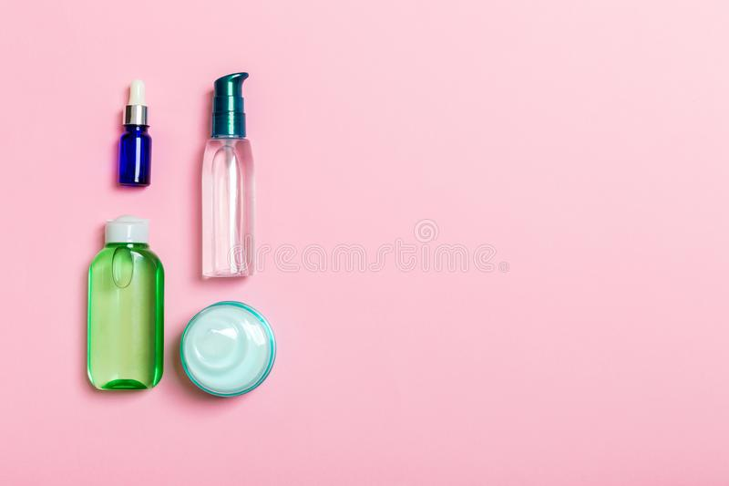 Cosmetics SPA branding mock-up, top view with copy space. set of tubes and jars of cream flat lay on pink background.  stock image