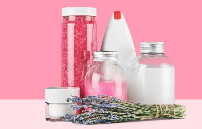 Cosmetics. Spa treatment moisturizer pink bottle bath salt nature royalty free stock photography