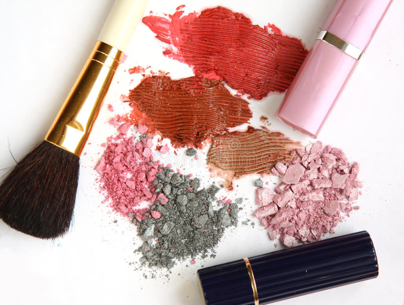 Cosmetics and tools. Various cosmetics and applicator brush stock image