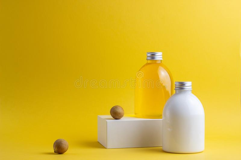 Cosmetics on a yellow background. Minimalism. Skincare. stock photo