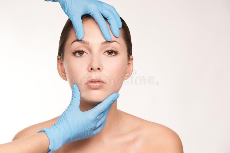 Cosmetologist apply mentoplasty. Beauty girl skin do Facelift at cosmetology spa. Women model treatment.  stock image