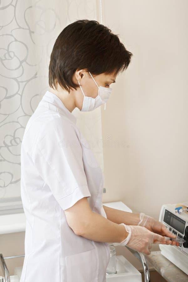 Cosmetologist filling syringe royalty free stock photography