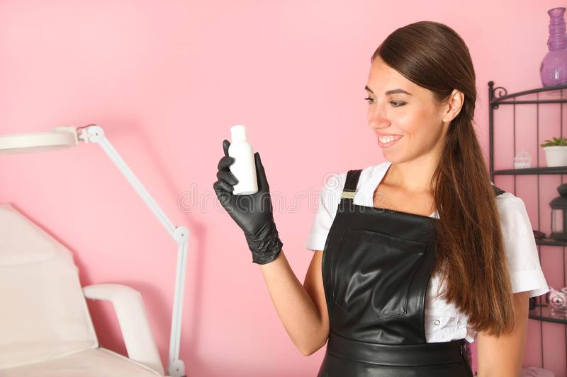 Cosmetologist with products for body care stock photos