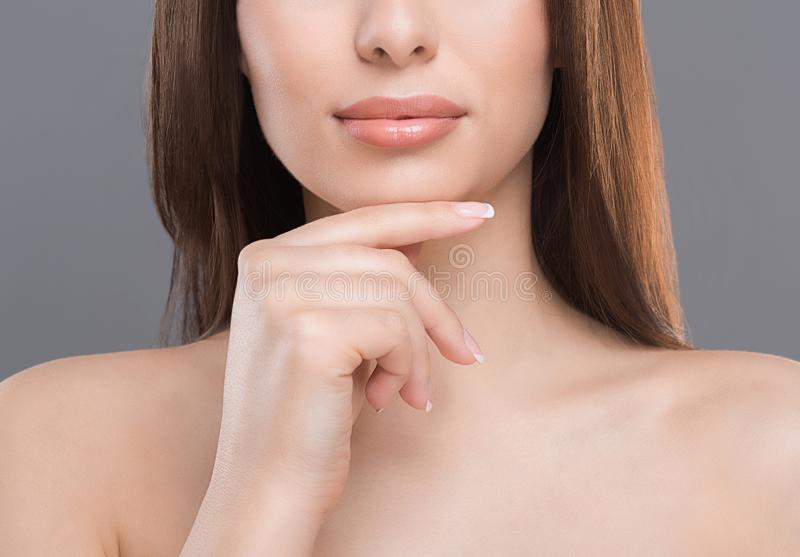Half portrait of young woman with perfect skin. Cosmetology, beauty and spa. Half portrait of young woman with perfect skin, close up stock photos
