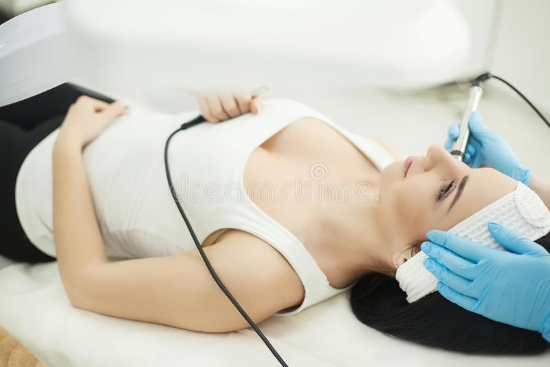 Cosmetology. Ultrasonic face cleaning, peeling, in a beauty salon royalty free stock photo