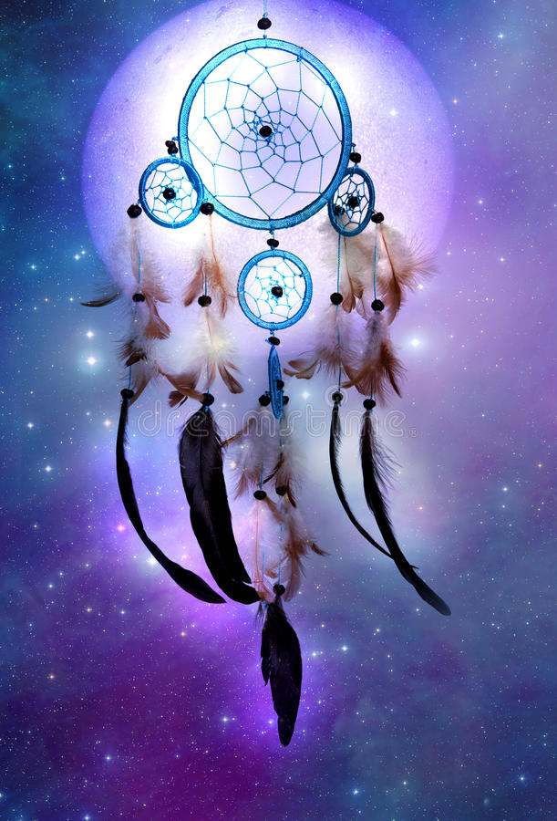 Cosmic dreamcatcher. A magic dreamcather over cosmic background with stars and a planet royalty free stock photo