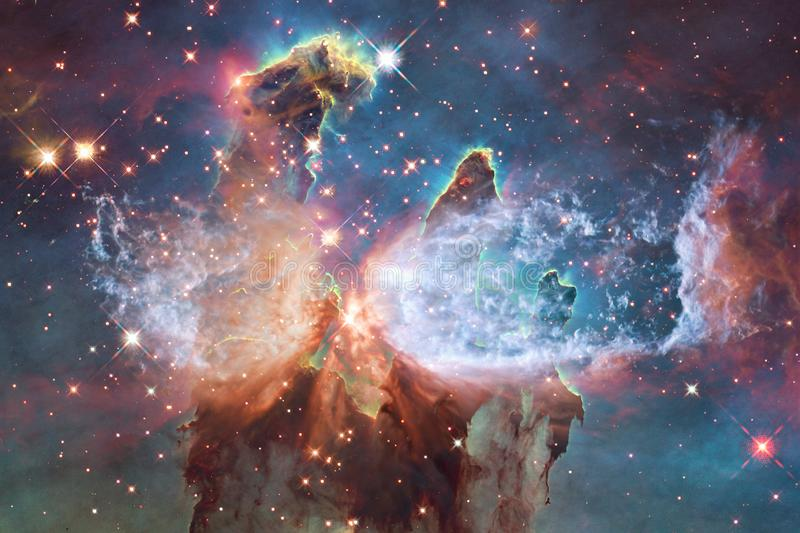 Cosmic galaxy background with nebulae, stardust and bright stars. Elements of this image furnished by NASA stock photography