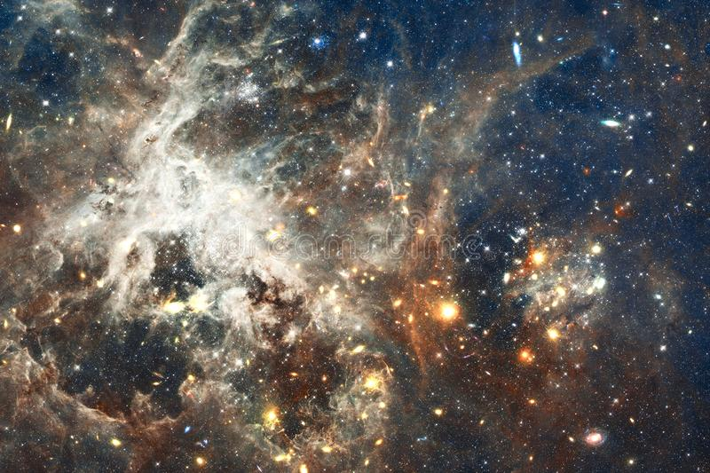 Cosmic galaxy background with nebulae, stardust and bright stars. Elements of this image furnished by NASA.  royalty free stock images