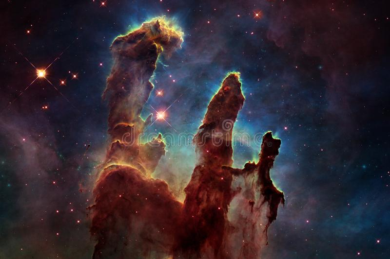 Cosmic galaxy background with nebulae, stardust and bright stars. Elements of this image furnished by NASA royalty free stock photography
