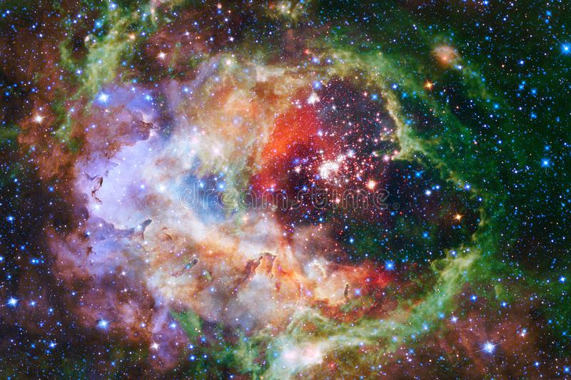 Cosmic galaxy background with nebulae, stardust and bright stars. Elements of this image furnished by NASA stock photos