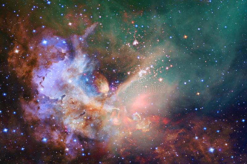 Cosmic galaxy background with nebulae, stardust and bright stars. Elements of this image furnished by NASA royalty free stock photos