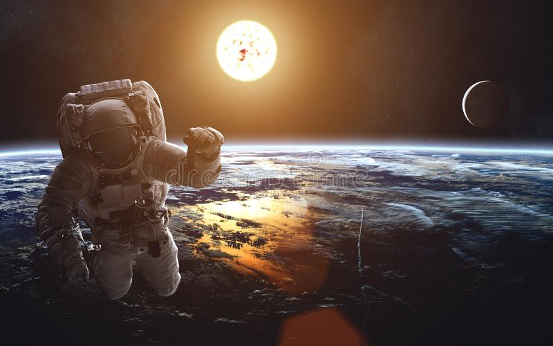 Cosmic landscape of Earth. Moon. Sun. Astronaut. Solar System. Elements of the image are furnished by NASA stock illustration