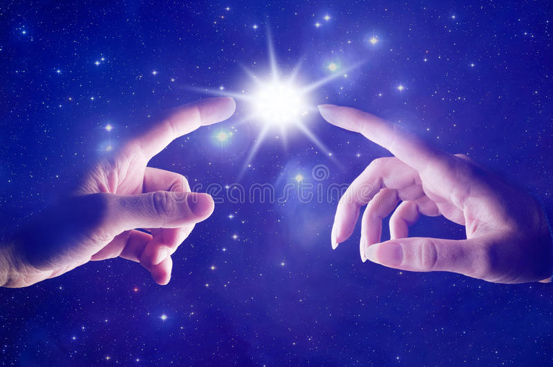 Cosmic spiritual touch stock image