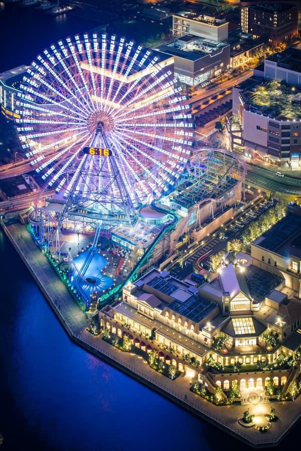Cosmo Clock 21 ferris wheel at night. View of Cosmo Clock 21 ferris wheel at night, at the Cosmo World amusement park, Yokohama, Japan stock photo