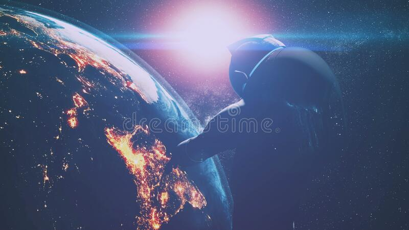 Cosmonaut over illuminated planet Earth and bright sunlight stock photos