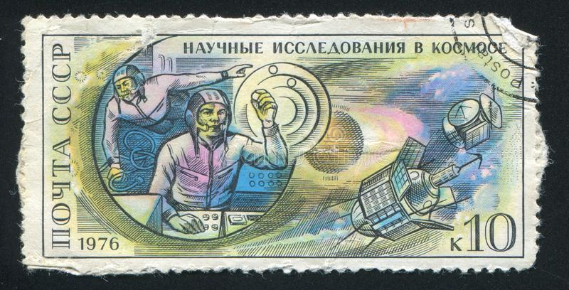 Cosmonauts on board Salyut space station and Mars planetary stat. RUSSIA - CIRCA 1976: stamp printed by Russia, shows Cosmonauts on board Salyut space station royalty free stock photo
