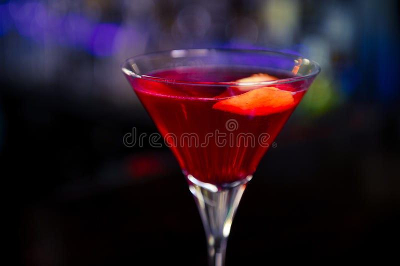 Cosmopolitan cocktail on the bar. Cosmopolitan classy cocktail on the bar stock photography