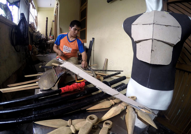 Cosplay armor. Craftsmen are making cosplay armor of wood and cardboard in the city of Solo, Central Java, Indonesia royalty free stock photography
