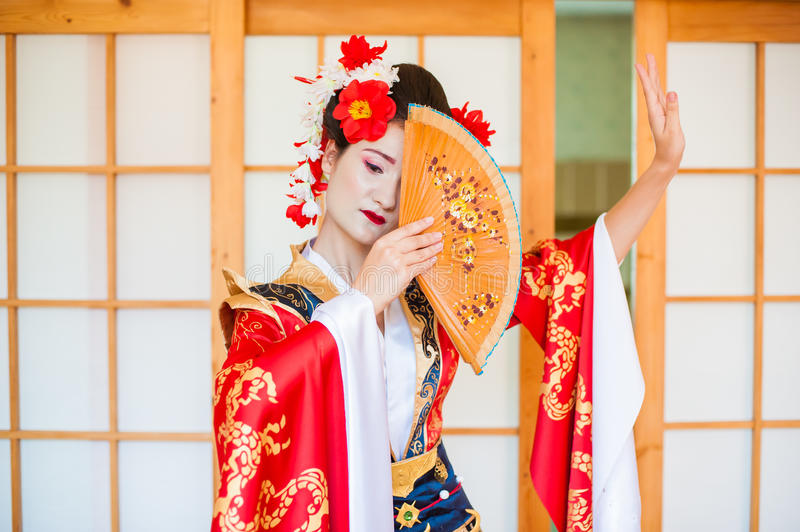 Cosplay. beautiful, modest geisha in a red kimono stock images