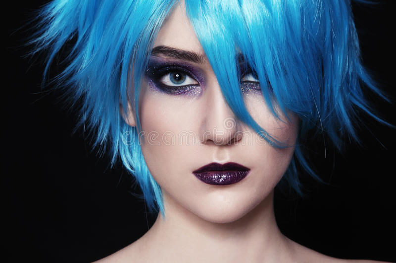 Cosplay. Close-up portrait of yound beautiful woman in blue cosplay wig royalty free stock images