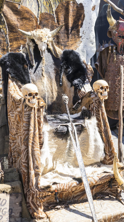 Cosplay, Throne of furs and skulls with a Viking sword. Chair wi stock images