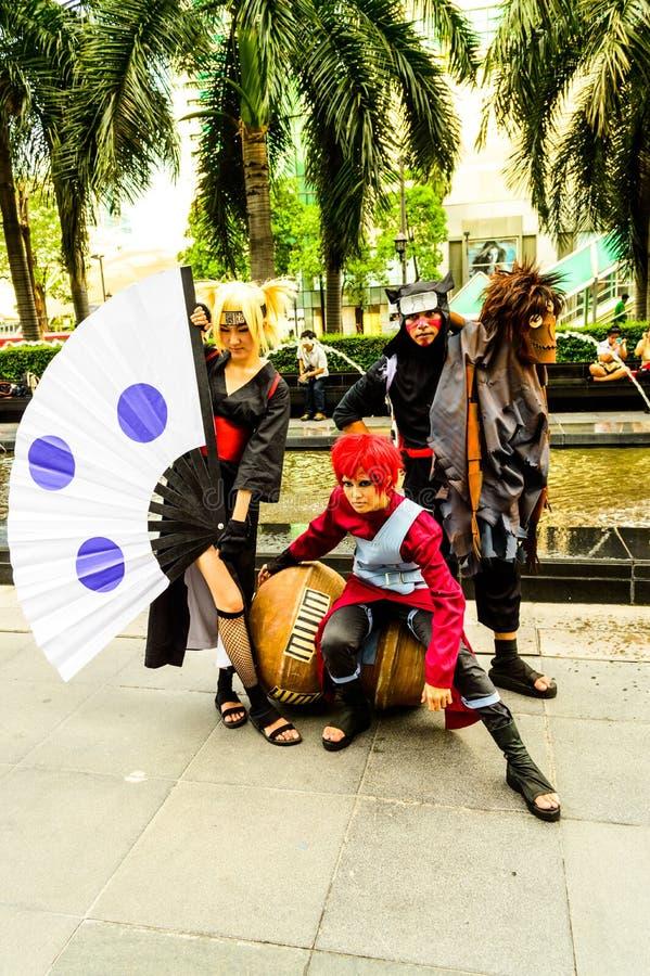 Cosplayer as characters Gaara, Kankuro and Temari from Naruto.