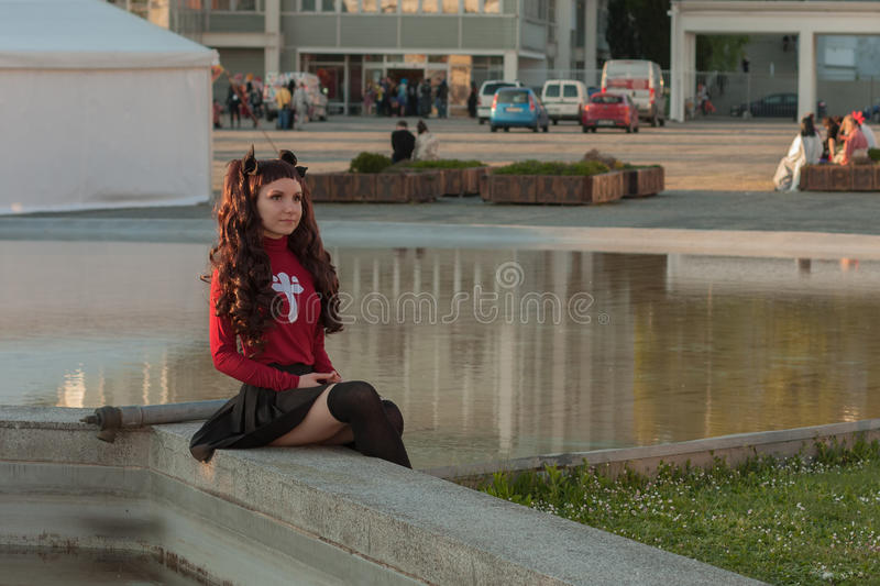 Cosplayer dressed as the characters Rin Tohsaka. BRNO, CZECH REPUBLIC - APRIL 30, 2016: Cosplayer dressed as the characters Rin Tohsaka from anime Fate/stay royalty free stock photography