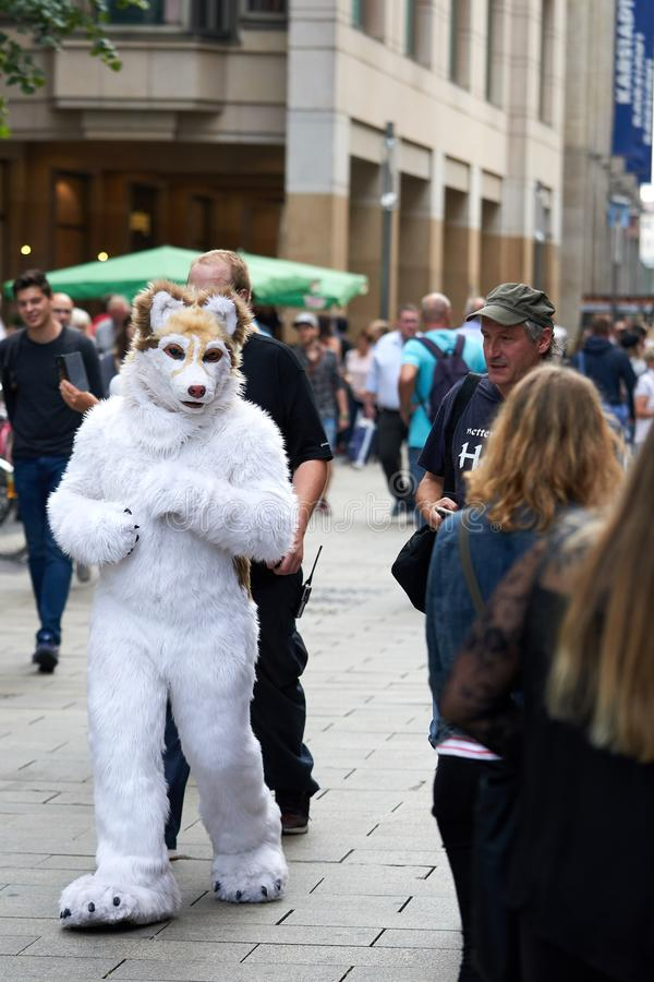 Cosplayers in the city center of Leipzig. Cosplayers disguised as animals go through the city center of Leipzig stock photos