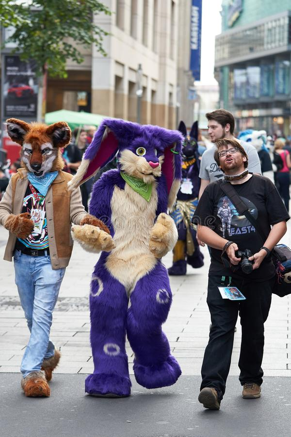 Cosplayers in the city center of Leipzig. Cosplayers disguised as animals go through the city center of Leipzig stock image