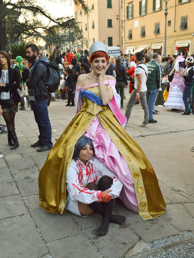 Cosplayers at Lucca Comics and Games 2014. A couple of cosplayers during the Lucca Comics and Games 2014 festival. Lucca Comics & Games is an annual comic book stock image