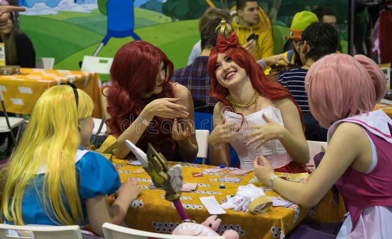 Cosplayers playing table game at the Gamefilmexpo festival. Moscow, Russia - November 19, 2016: Cosplayers playing table game at the Gamefilmexpo festival royalty free stock photography