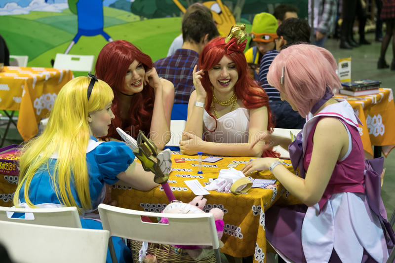 Cosplayers playing table game at the Gamefilmexpo festival. Moscow, Russia - November 19, 2016: Cosplayers playing table game at the Gamefilmexpo festival royalty free stock image