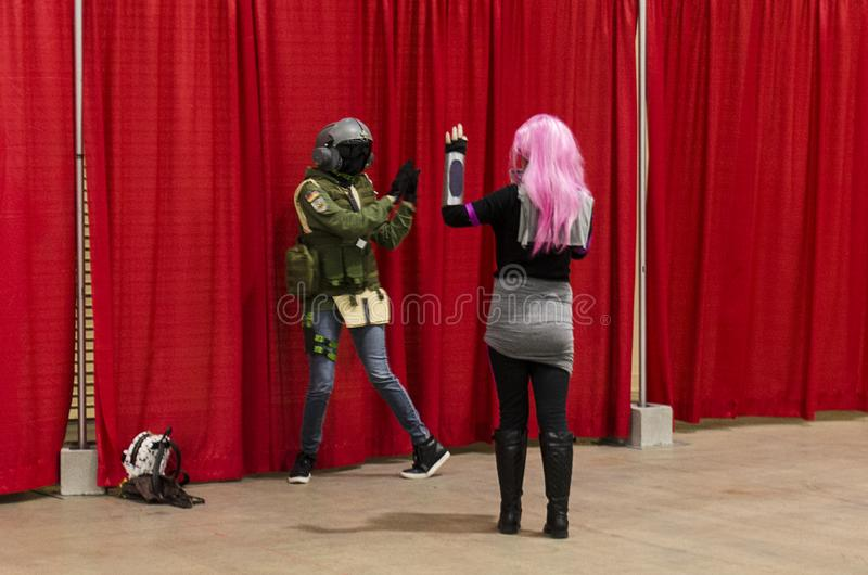 Cosplayers posing at the Comic Expo. Cosplayers pose at the 2019 Comic Expo at the Albuquerque Convention Center in New Mexico stock photos
