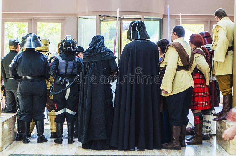 Cosplayers posing and forming a Star Wars Universe for photographers at the Comic Expo. Cosplayers posing and forming a Star Wars Universe for photographers at royalty free stock images