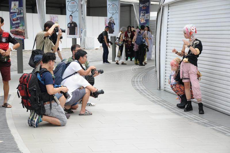 Cosplayers posing for photo taking by amateur hobbyist photographers. The event was Cosfest 2019 in Singapore on 21 July 2019 Sunday royalty free stock photo