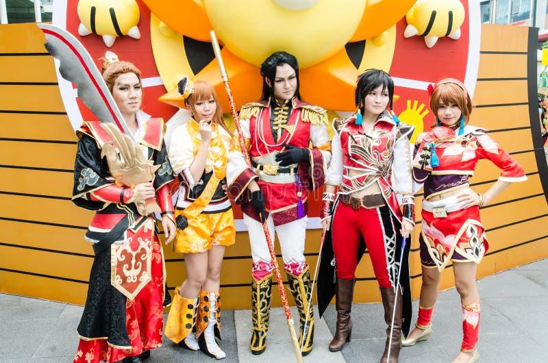 Cosplayers som teckendynastikrigare i den Oishi världen Cosplay fantastiska 7 arkivfoto
