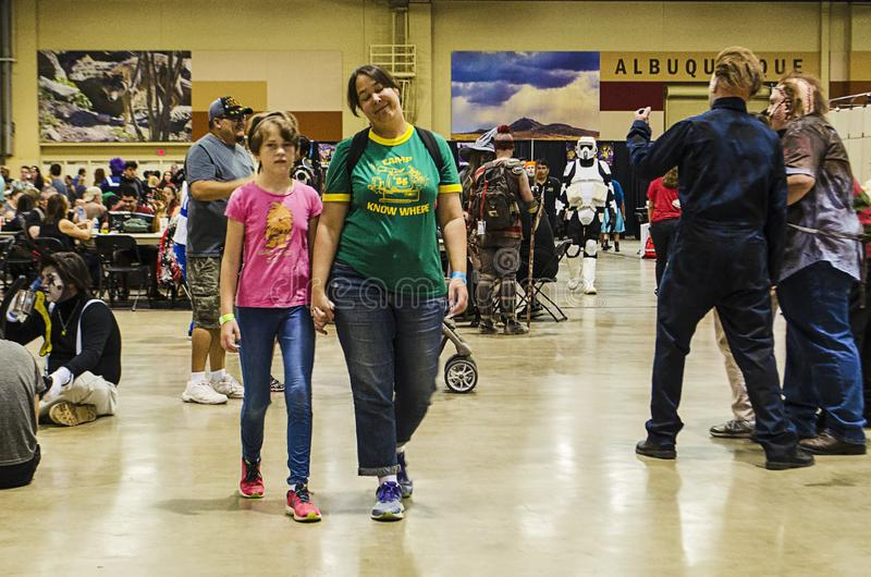 Cosplayers, visitors, fans and photographers populate the Comic Expo. Cosplayers, visitors, fans and photographers populate the 2019 Comic Expo at the royalty free stock image