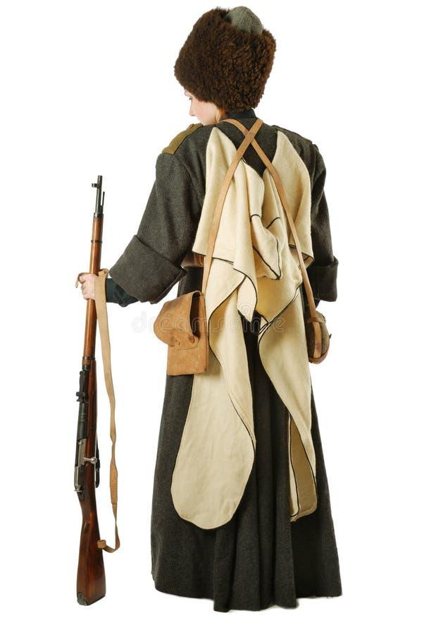 Cossack do russo que está para trás com rifle. imagens de stock royalty free