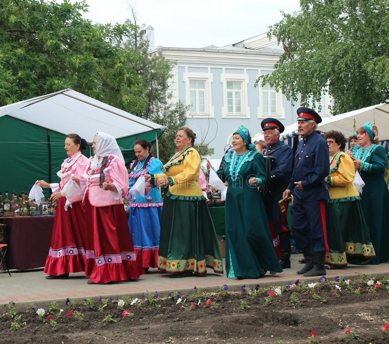 Cossack song. Cossacks sing a song to the accordion at the birthday of Mikhail Sholokhov in Vyoshenskaya, Russia royalty free stock photos