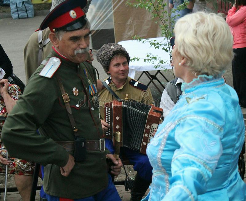 Cossack song. Cossacks sing a song to the accordion at the birthday of Mikhail Sholokhov in Vyoshenskaya, Russia royalty free stock photo