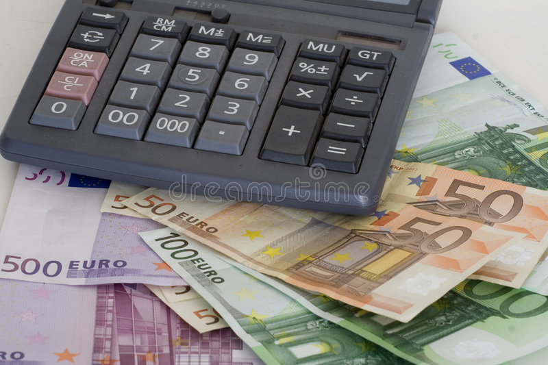 Cost control. European bills and calculator royalty free stock photo