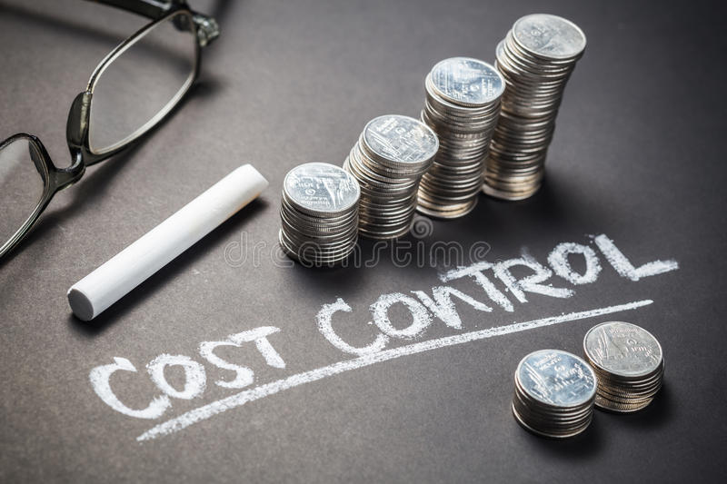Cost Control and Coins. Handwriting of Cost Control with heap coins stock photos