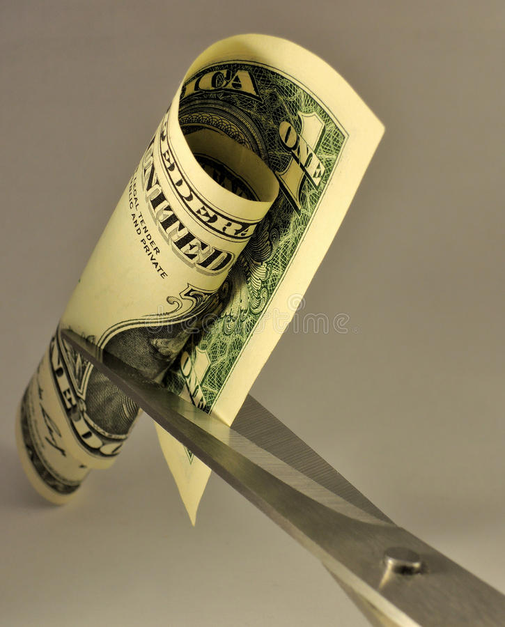 Cost cutting metaphor. Metaphor of cost cutting idea stock photography