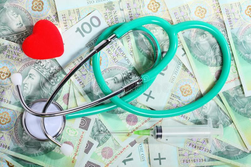 Cost of health care: stethoscope red heart polish money. Medical treatment and high cost for a good health care service concept: stethoscope red heart money royalty free stock images