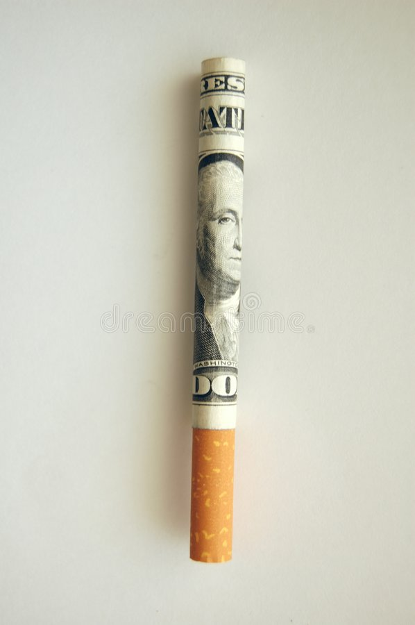 Cost of smoking. Conceptual image of a cigarette made of a dollar bill stock images
