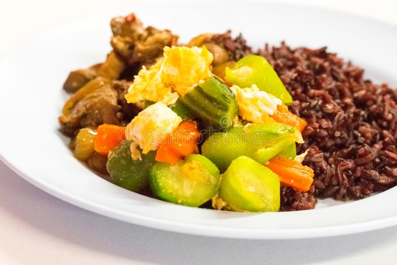 Cost-up Thai food menu is rice berry,Stir-fried Zucchini with Egg royalty free stock photo